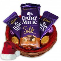 Three Silk Chocolates gift wrapped in a basket