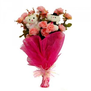 2 Teddies 6 inches each and 12 pink roses in same hand bunch