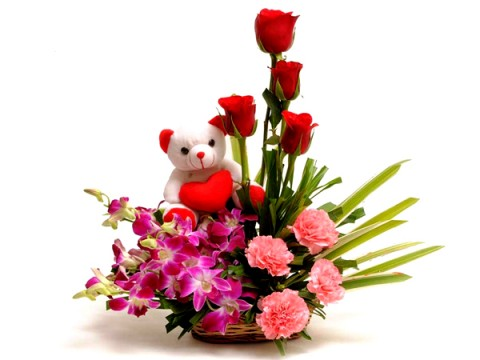 4 Red Roses 4 Orchids 4 Pink carnations basket and teddy�(6 inches)