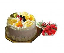 Half Kg fresh fruit cake with 6 red roses