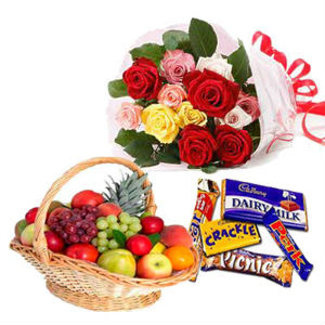 2 Kg. Fresh Fruits, 2 Packs Cadburys Chocolates and a Few Roses in a Basket