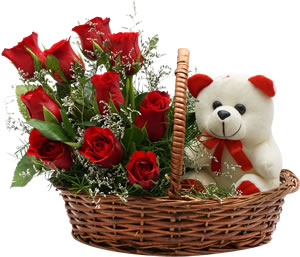 12 Red roses with 6 inches Teddy bear in the same basket