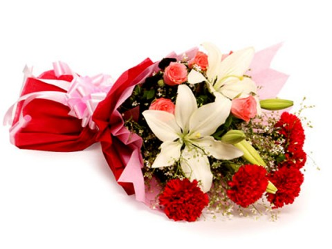 White lilies with red carnations in a bouquet