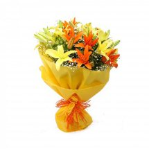 Yellow and orange lilies in a hand bouquet