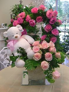24 pink roses with Teddy arranged in the same basket