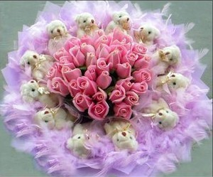 Bouquet of 12 pink roses surrounded by 12 Teddies 6 inches each