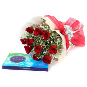 12 red roses with a chococlate celebration box