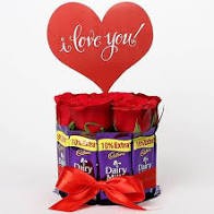 6 Red Roses Teddy 10 dairy milk Chocolates Gift wrapped in a round circle with Red ribbon with a Valentine Heart