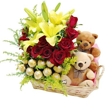 16 ferrero 6 red roses 2 yellow lilies surrounded by 2 Teddies 6 inches each in a basket