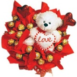16 Ferrero chocolates in a bouquet with 12 inches Teddy